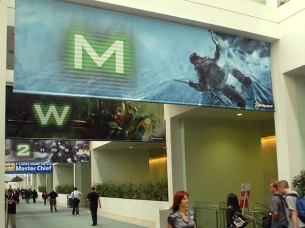 These two-sided, hanging vinyl banners help guide attendees and announce the release of new games.