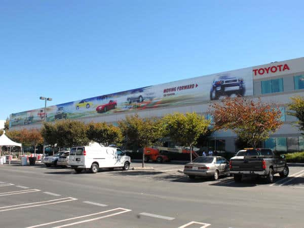 How do you celebrate your 50th anniversary when you have over 1000 employees? Toyota threw this parking lot party and wanted to appropriately decorate their buildings. This giant continuous banner extends over 200 feet and features a timeline of their most popular vehicles.